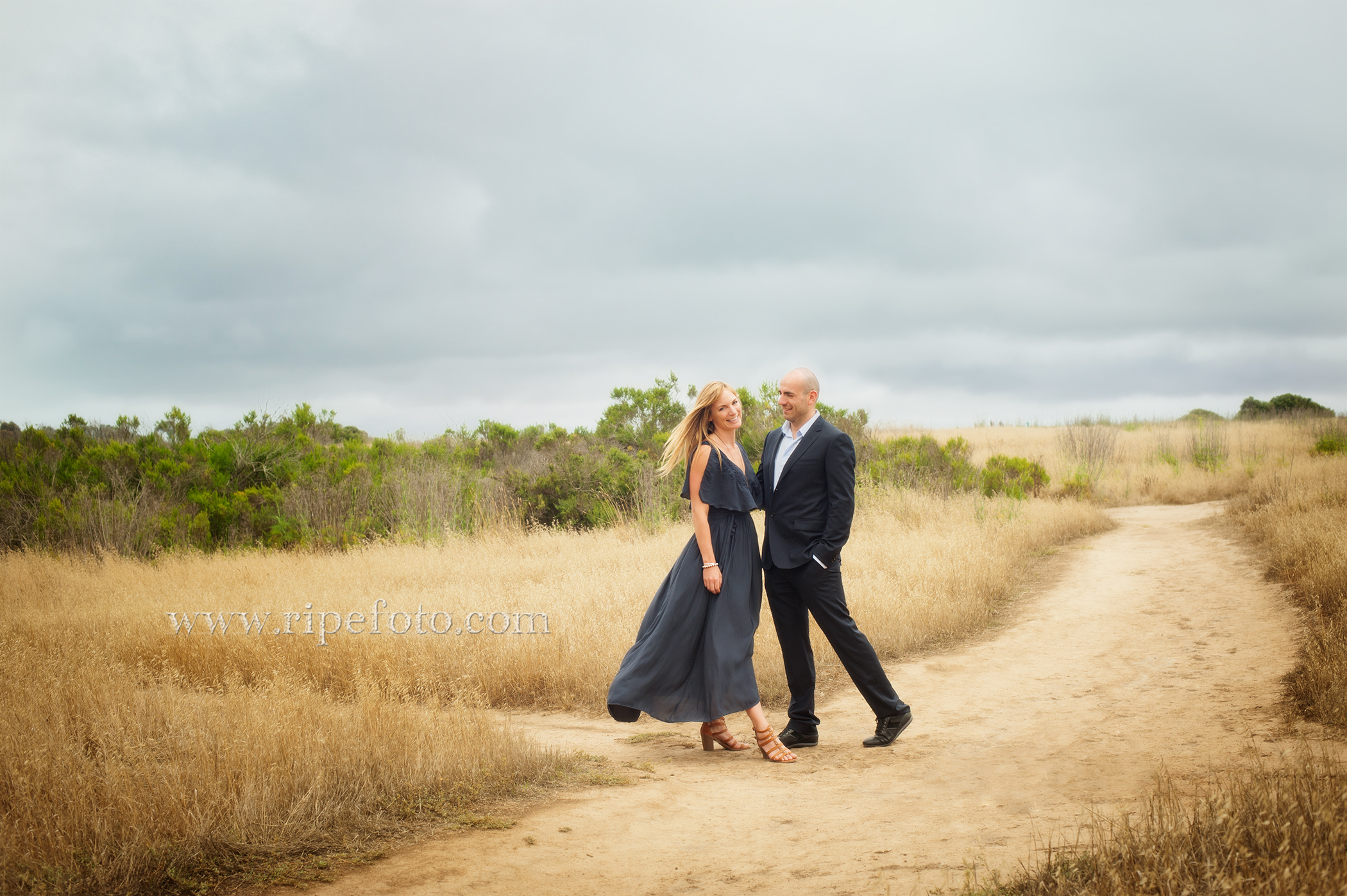 Portrait of couple at the Monarch Butterfly Preserve in Santa Barbara by engagement photographers at Ripe Photography.