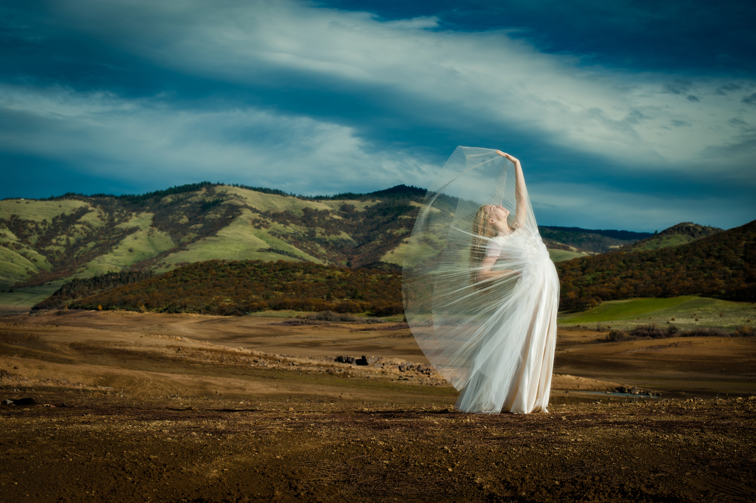 Fine art portrait of woman in mountains by portrait photographers at Ripe Photography in Portland, Oregon.