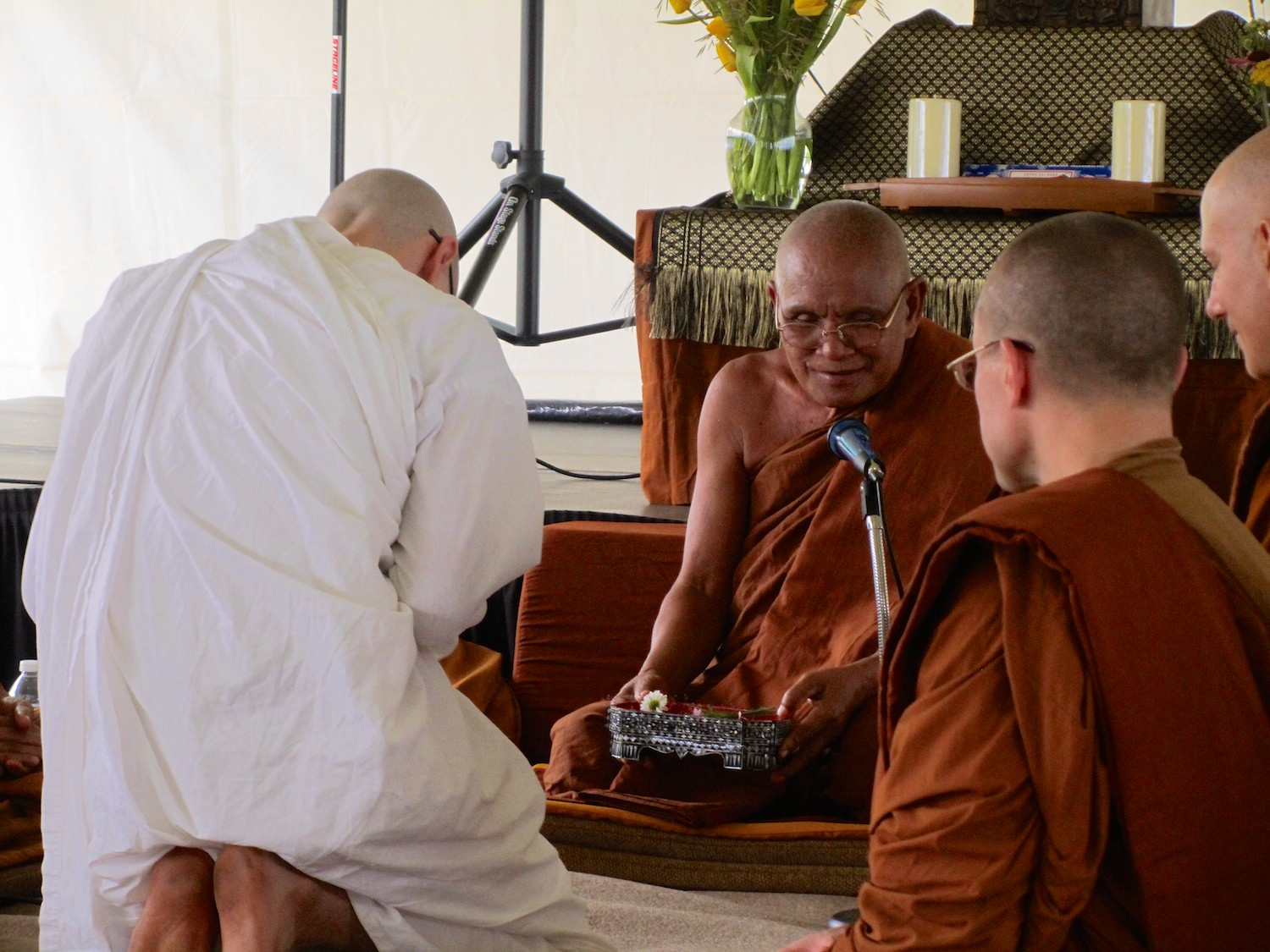 Luang Por Liem instructs Anagarika Zack – now Samanera Suñño – during his novice ordination