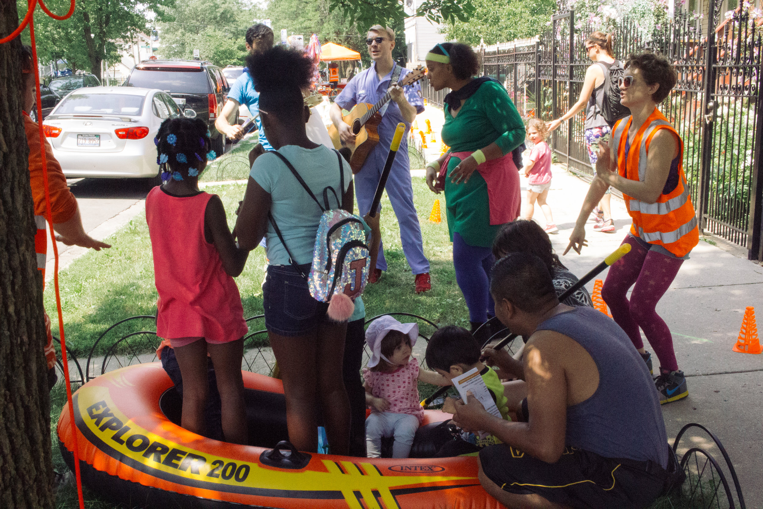 Opera-Matic artists, LUCHA residents, & neighbors participate in a Sidewalk Celebration, summer 2017