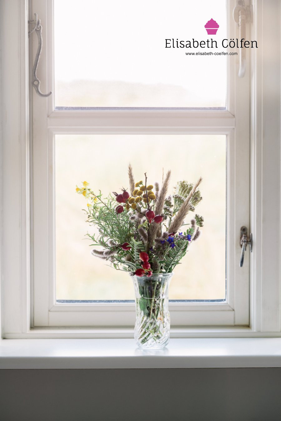Wooden window with a bouquet of wild flowers found in the dunes in a window