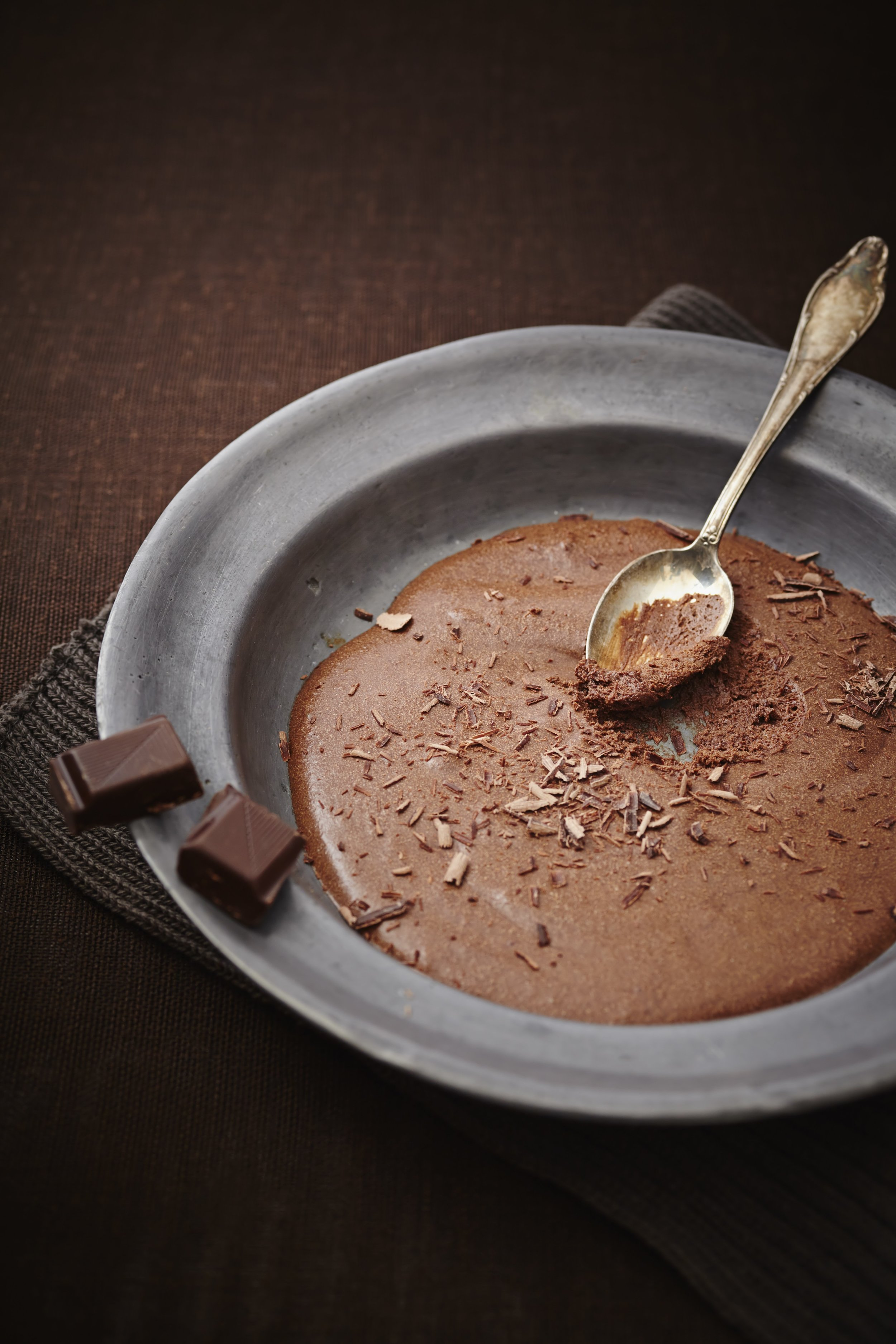 Mousse au Chocolat with spoon on plate