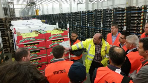 (ABOVE) A warehouse and logistics manager walks though the operation