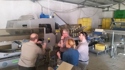 (ABOVE) Quality control measures are reviewed on a tour of the packing facility