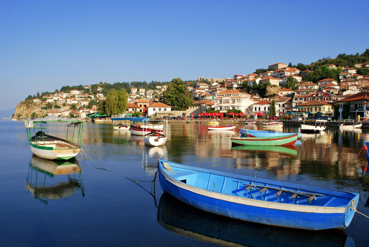 Fishing boats sway in the waters of Lake Ohrid, a World Heritage property. PHOTOGRAPH BY MALIJA, GETTY IMAGE