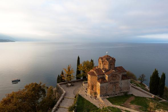 The Church of Saint John at Kaneo overlooks the calm waters of Lake Ohrid. PHOTOGRAPH BY PASCAL MEUNIER, REDUX