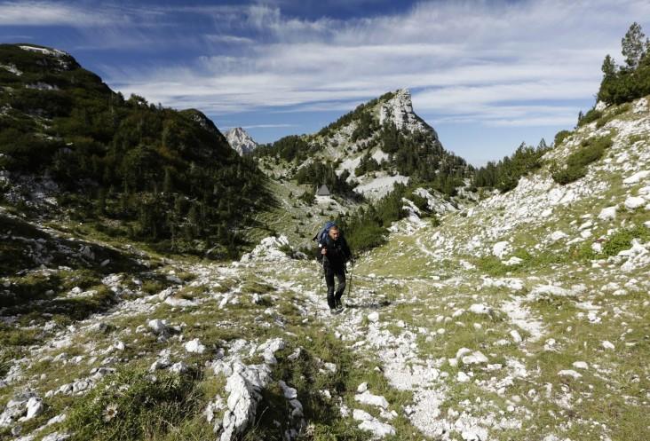 Kenan Muftic walks along the Via Dinarica on Prenj Mountain, Bosnia and Herzegovina - Elma Okic