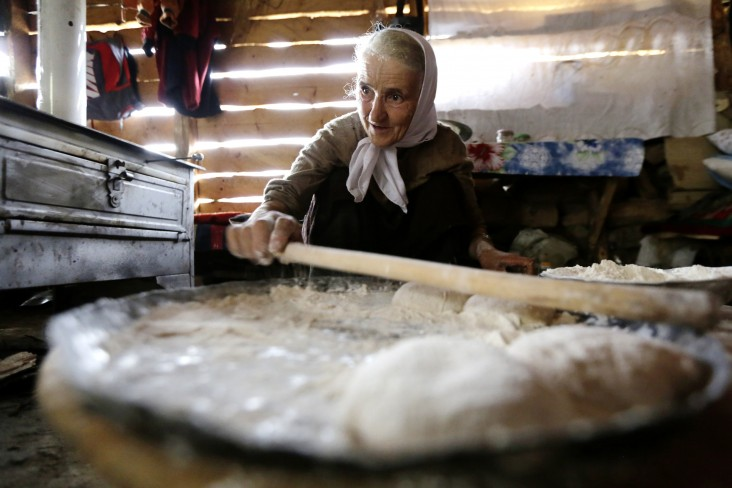 A woman in Bosnia and Herzegovina makes traditional bread - Elma Okic