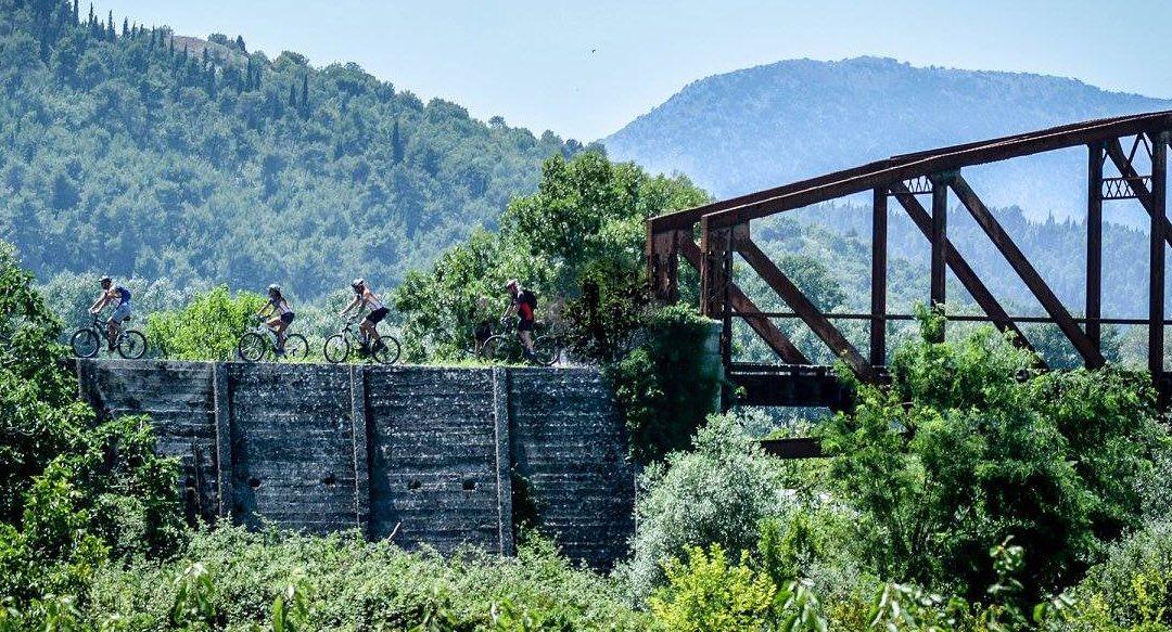 Crossing an old railway bridge. Photograph: Goran Prskalo