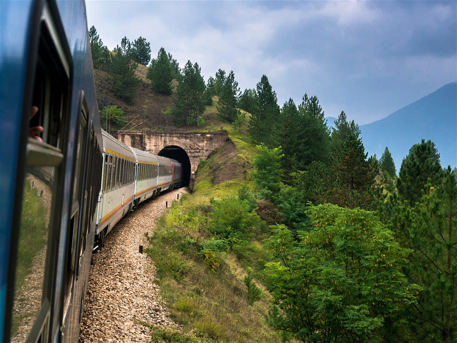 Belgrade–Bar train entering one of the numerous tunnels that dot the route © Pe3k / Shutterstock