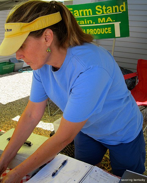 Grower Betsy McCarron of The Farm Stand, Colrain, MA, selling vegetables at the Lee Plaza East rest are on the the Mass. Turnpike (I-90)