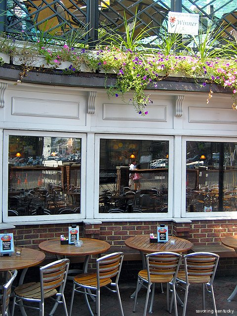 Windows overlook the exterior patio at Cheapside Bar & Grill, Lexington, Kentucky