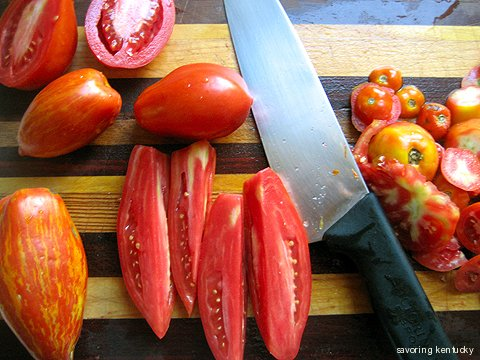 Cutting plum tomatoes for ketchup