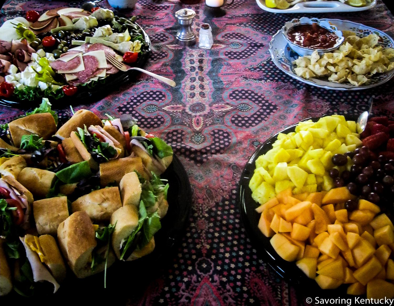 Good Foods antipasto platter, top left; mini-baguette sandwiches, lower left, large fruit tray bottom right