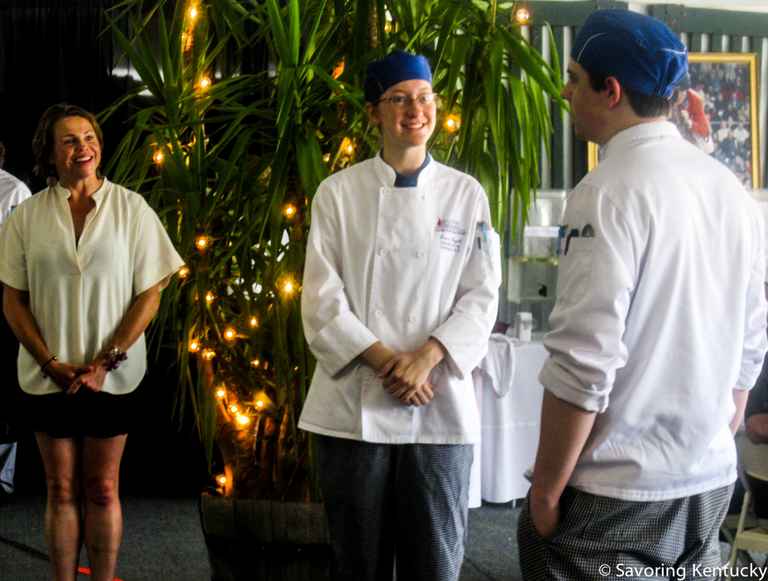 Crave Festival director Robbie Morgan, left, looks on as Sullivan student chefs Laura Vogel and Will Unseld describe their meal opening trio of smoked soups.