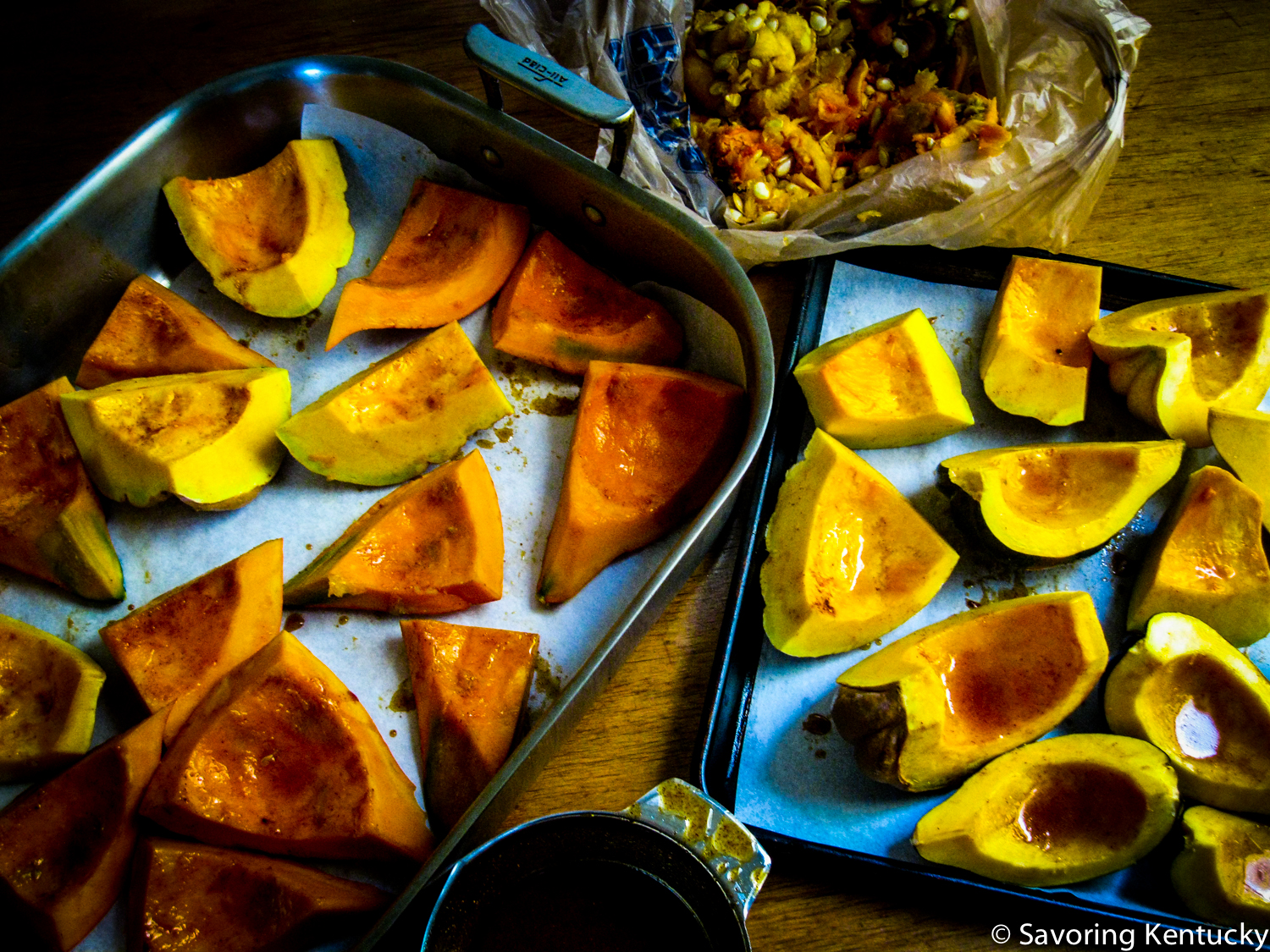 A mix of winter squashes ready for roasting: cut and rubbed with a seat-of-the-pants blend, below; seeds and pith extracted for the neighborhood chickens, above. (Better people than we are might clean, roast, and eat those seeds, but at least we put them to good use!)