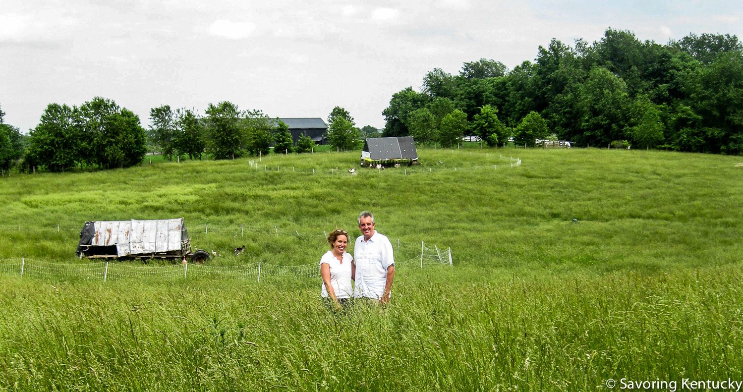 Grass matters at Elmwood Stock Farm, and grass matters to us eaters. Ann Bell Stone and Mac Stone stand in their early summer grasses, chicken tractors behind them, at this priceless Scott County farm. One more thing: world class photographer  Sarah Jane Sanders  produced a splendid photo  of these two standing in this field. We included that photo, and 87 other SJS wonders, in  Classic Kentucky Meals.