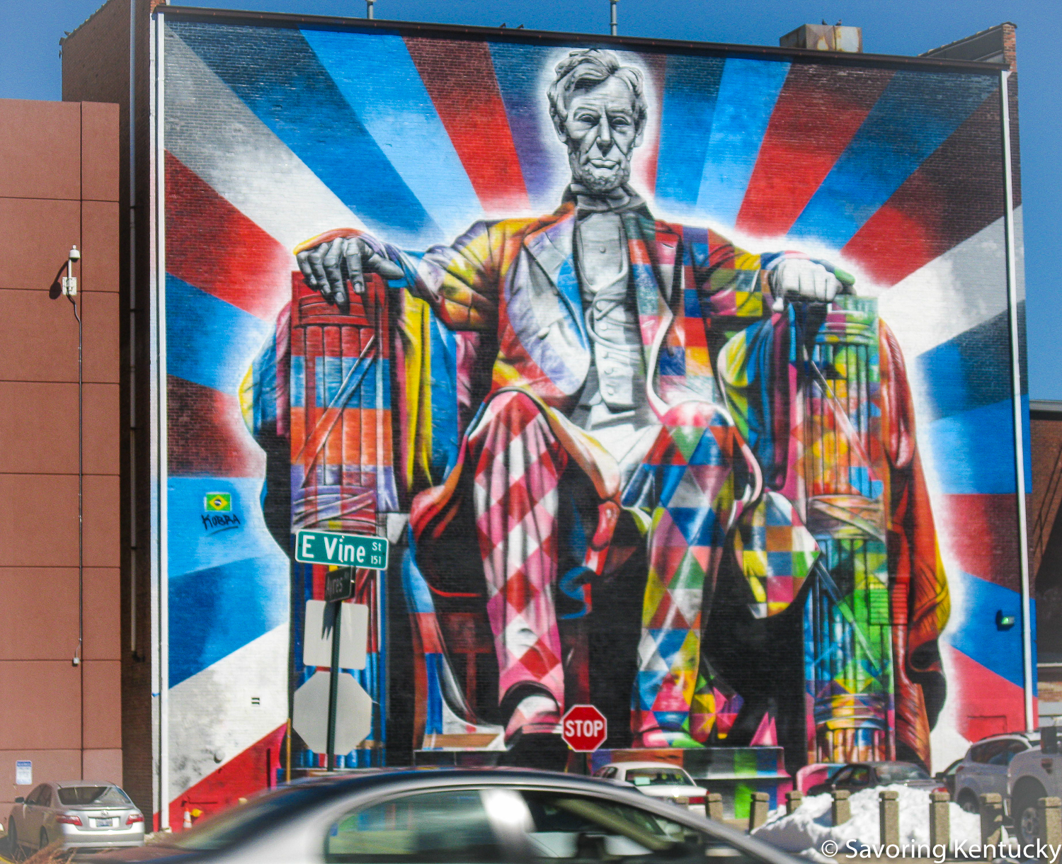Abe sits in the thick of things, right where he liked to be, on Vine Street in Lexington, in this spectacular  Eduardo Kobra  mural.