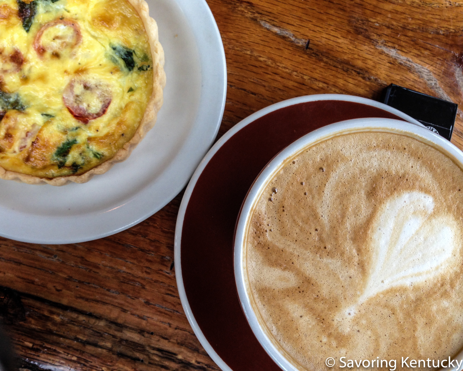 Quiche and breve latte at  Daily Offerings Coffee Roastery . The quiche and all pastries are gluten-free and made in house.
