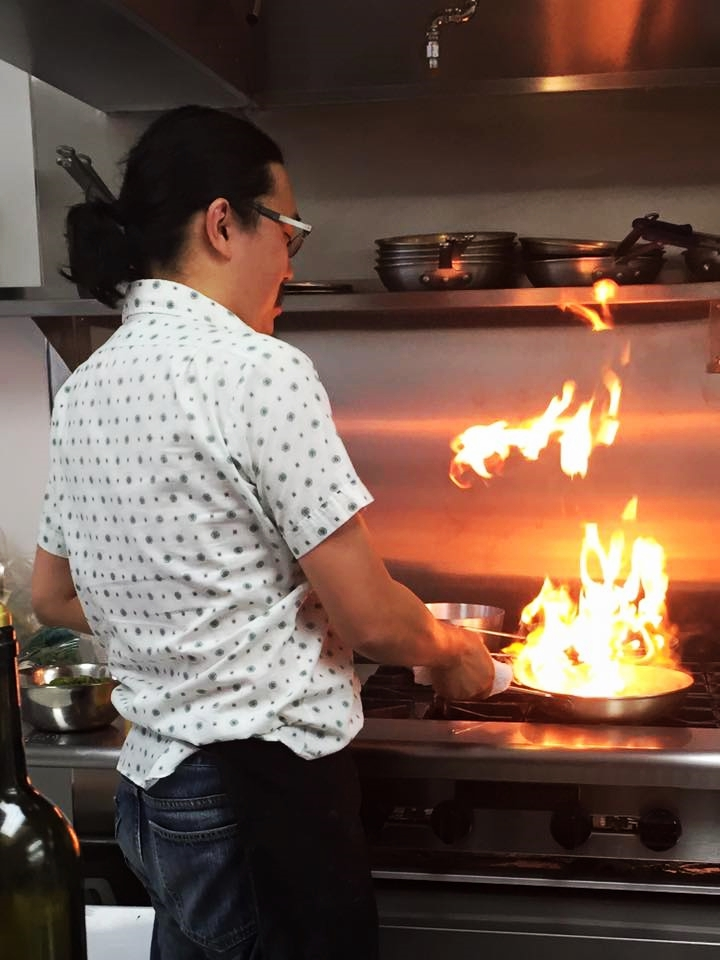 Dan Wu ,  Culinary Evangelis t, cooking with fire at  Pasta Garage .
