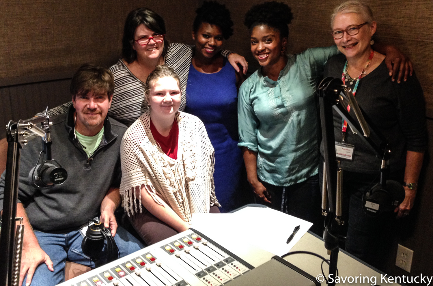 Co-hosts and guests at Hot Water Cornbread: Kentucky Food Radio, October 2015. From left, co-hosts Chris and Ouita Michel with their daughter (seated), Willa, and show guests Ashley Smith and Lacreesha Berry, co-host Rona Roberts.