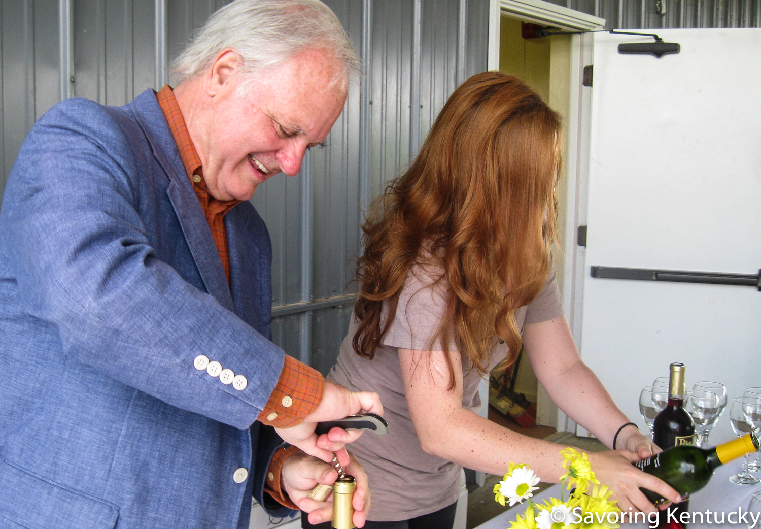 Harkey Edwards, left, and daughter Beth offering Harkness Edwards wines at the 2013 Food and Fiber Festival.