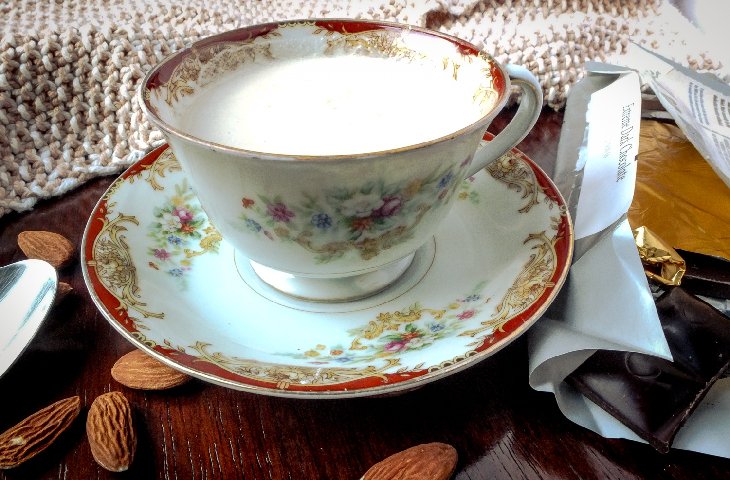 """Almond milk with a bit of Chocolove dark chocolate stirred in. Mother and Dad's 1938 """"china"""" from Japan. Linens by Judy Rosen."""