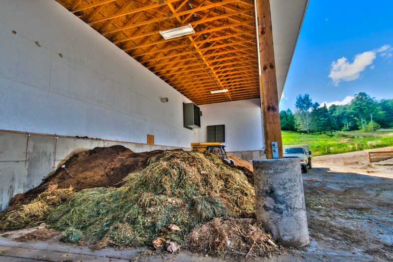 Solids are mixed with hay and sawdust sweepings from the barn in the curing bay. After a couple months compost is ready for use or sale.