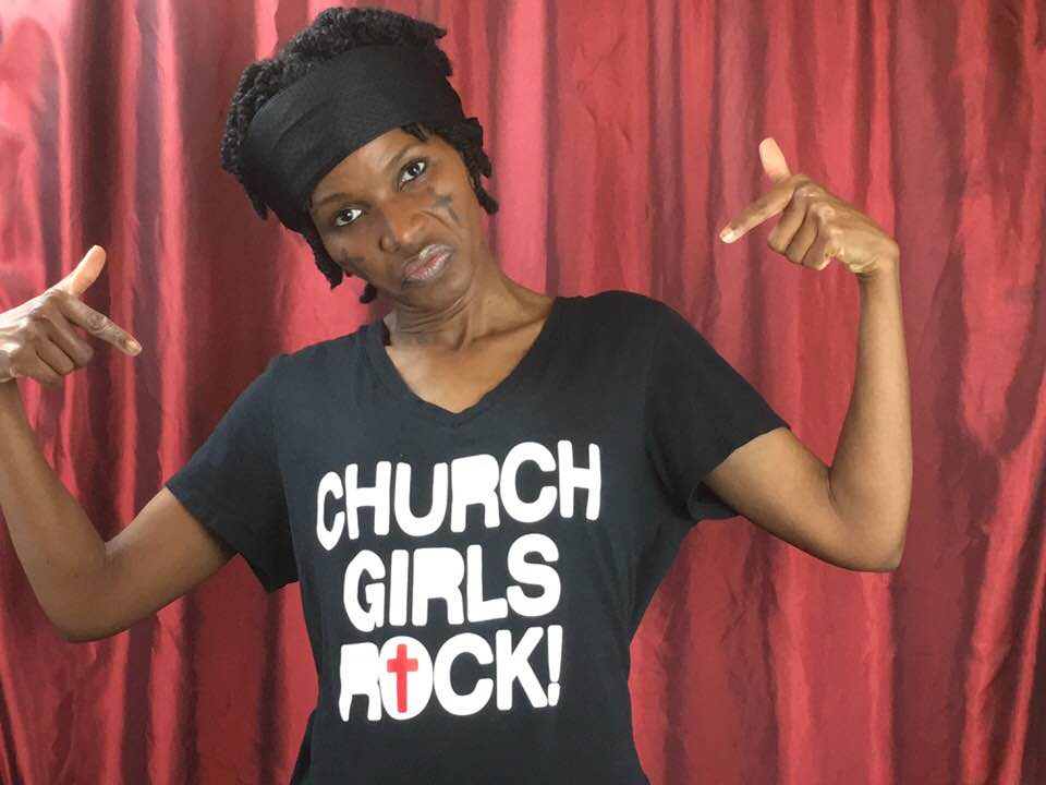 """""""Holy C"""" is a character (a Christian rapper)  who appears on my  """"When Black History Firsts Go Wrong"""" talk show parody . She is cheesy, bless her heart."""