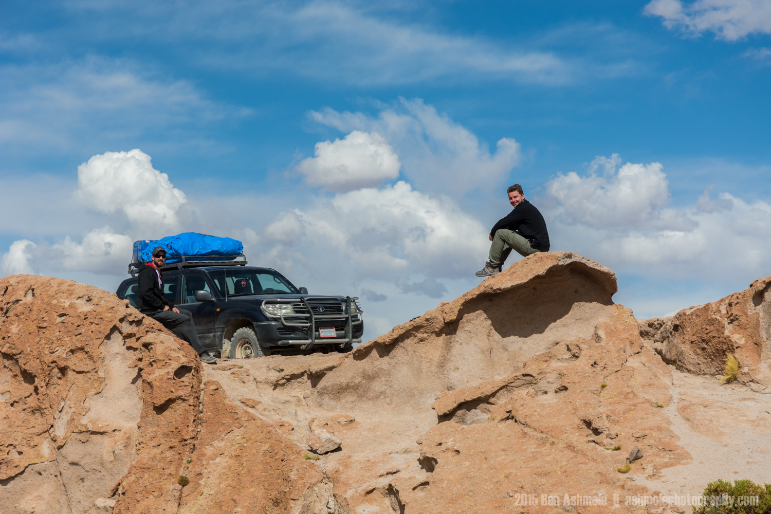 Sitting On Volcanic Rock Formation With 4x4, Bolivian Highlands