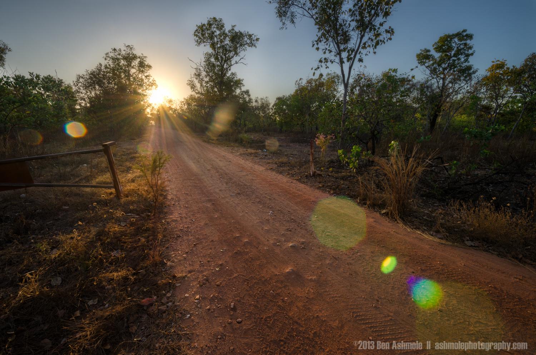 Red Dirt Road And The Sun, Kakadu National Park, NT, Australia