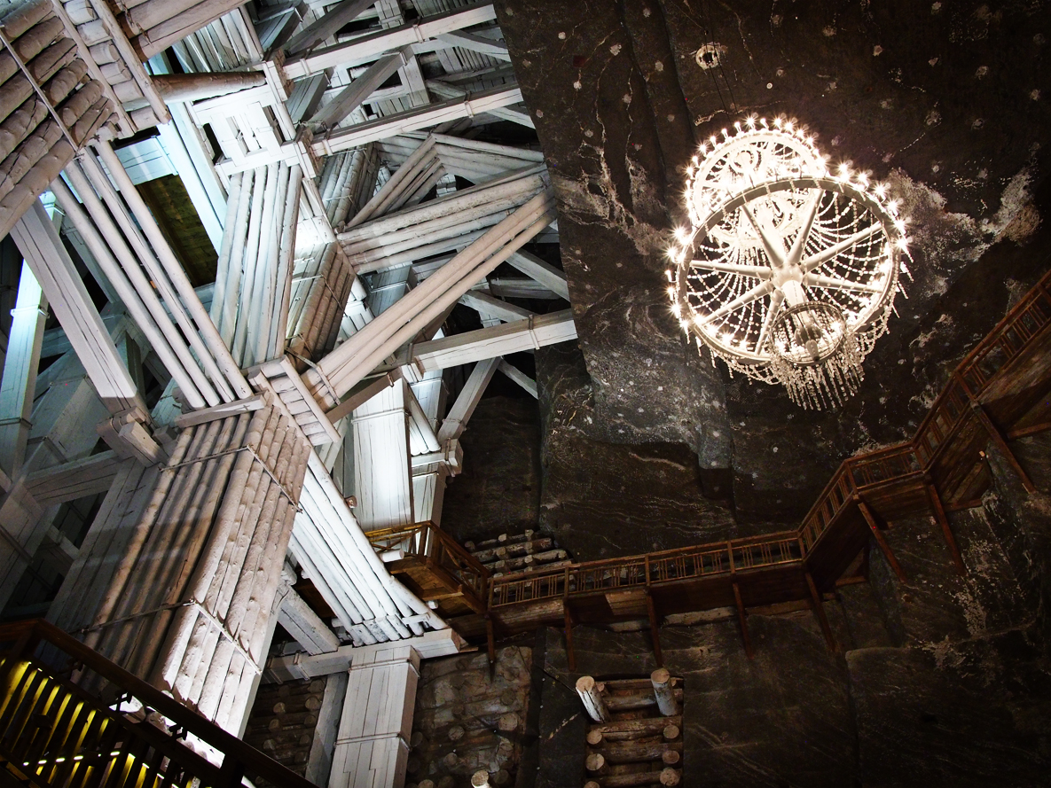 The mine is supported throughout with heavy wood beams. The beams become impregnated with salt and eventually petrify. These wood beams are coated in salt. The chandelier in this image is made of salt. Salt. Salt. Salt. Everything salt. Oh, and yes, you can lick the walls.