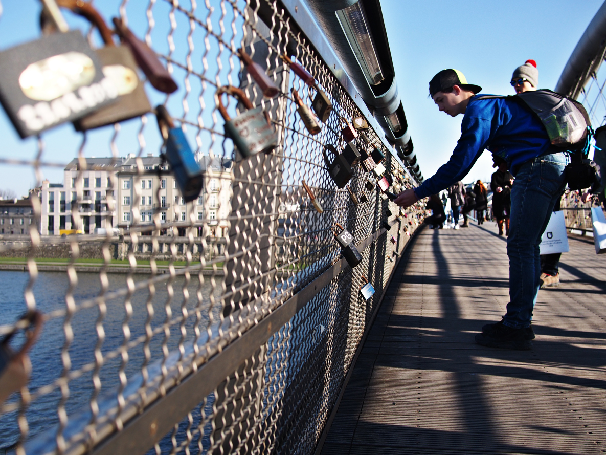 "A footbridge that crosses the Vistula River in Krakow is burdened with ""love locks."""