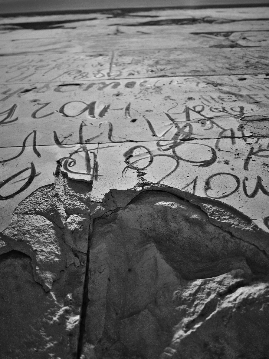 A wall of the Reichstag inside of the Bundestag - covered with charcoal graffiti by Russian solders after the Battle of Berlin.