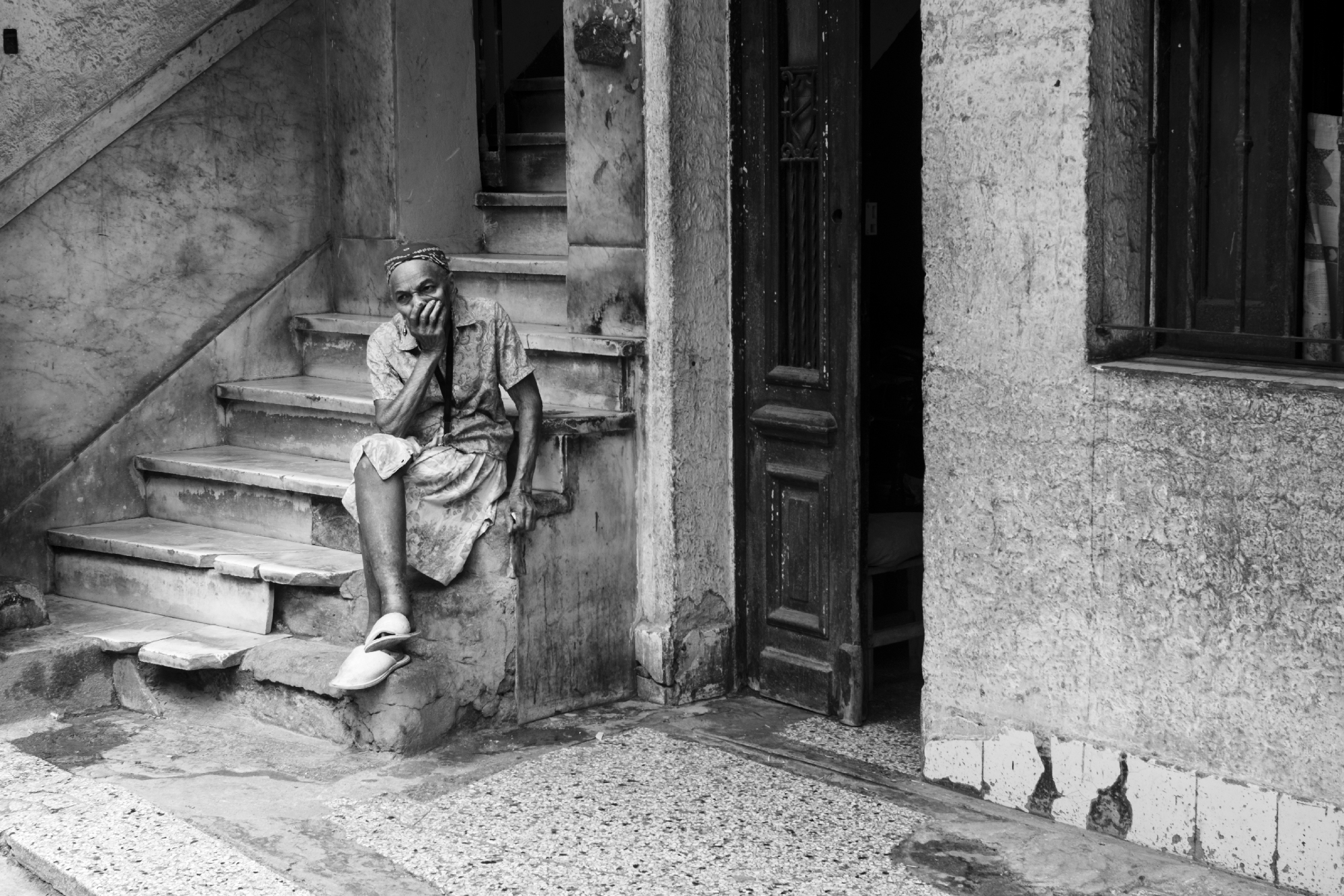 Most mornings and evenings are spent sitting in doorways or steps along the narrow streets.