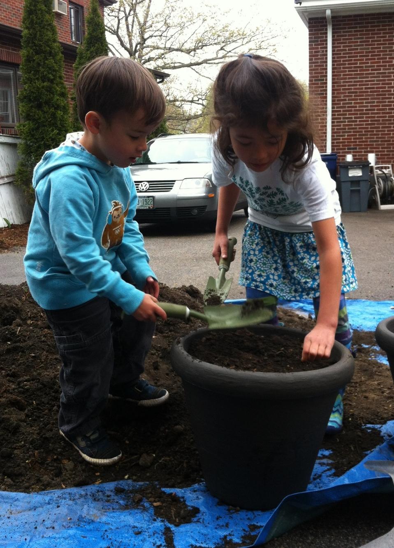 My niece and nephew planting seeds