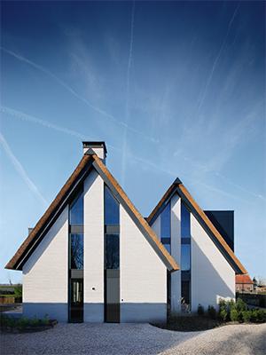 NOMAA modern landelijke luxe villa eigentijdse woning schuurwoning huis strakke architect zelfbouw kavel erker dakkapel riet rieten dak hoogkarspel streekweg stijlvol wonen excellent.jpg