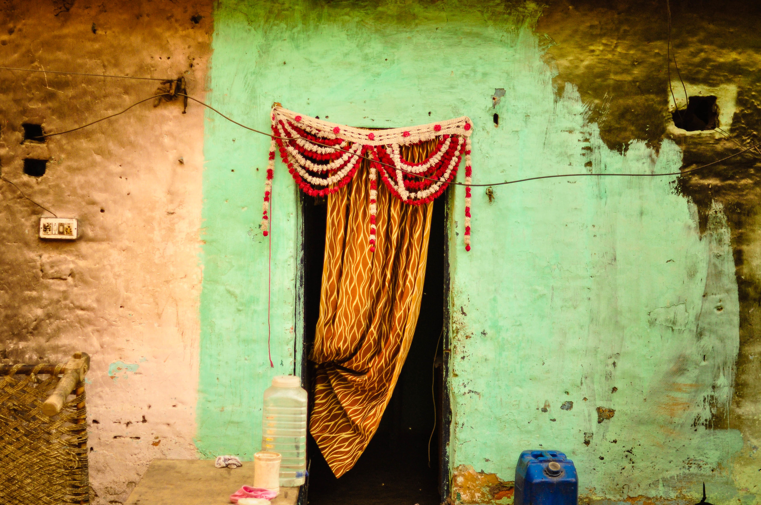 About 500 families live in Jasola Slum. They pay about $20 a month for one room that is no bigger than 10x10 square feet---the size of an American bathroom. Jasola Slum, India