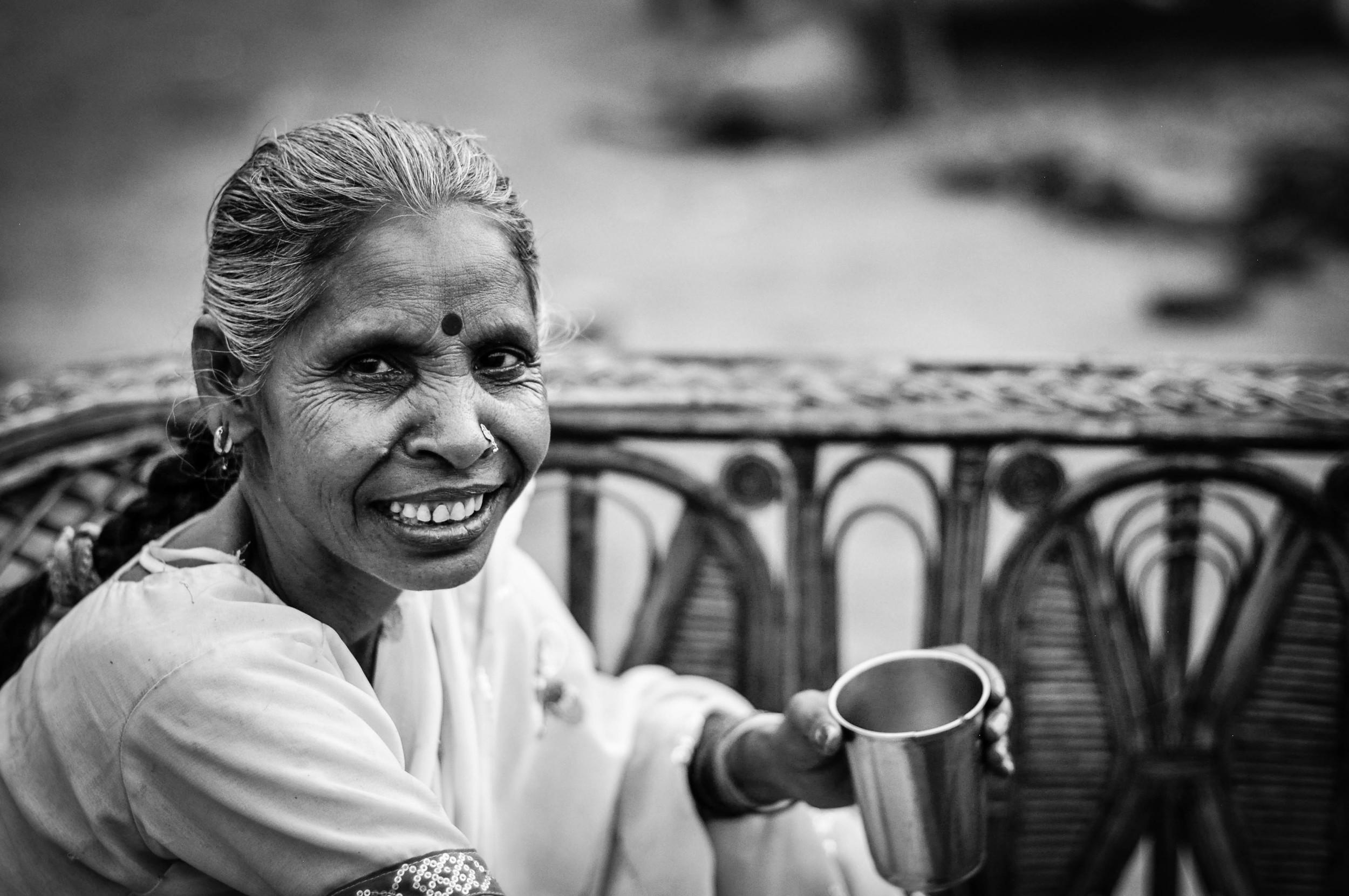 This woman is amazing. She makes me masala chai. Jasola Slum, India