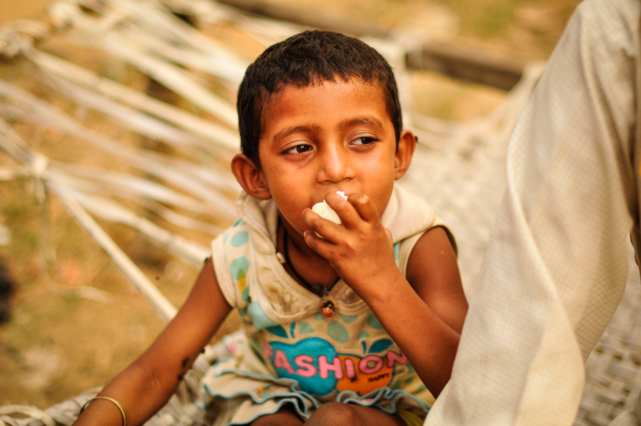 Children are not considered very precious in India---especially girl ones. This little one is paralyzed and does notreceiveenough nutritious food withprotein She's eating an egg we gave her here.