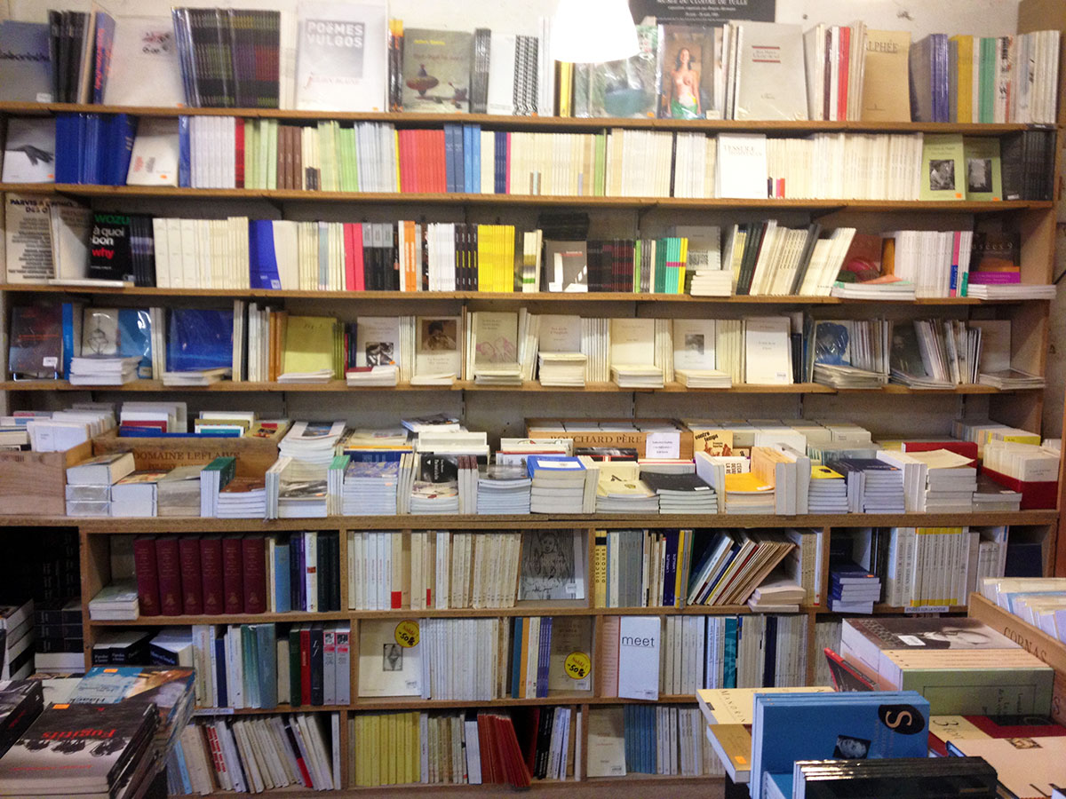 Bookstore in Paris / Second Floor Flat