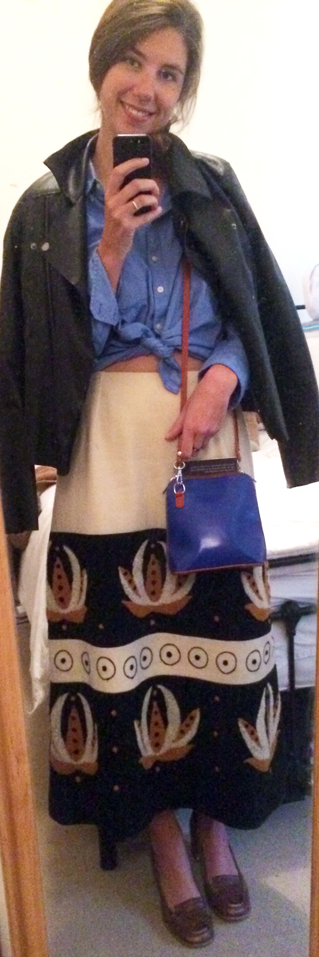 Thrifted Skirt,  Leather Jacket ,  Chambray Button-Down Shirt ,  Brown Leather Loafers ,  Cobalt Blue Crossbody Bag