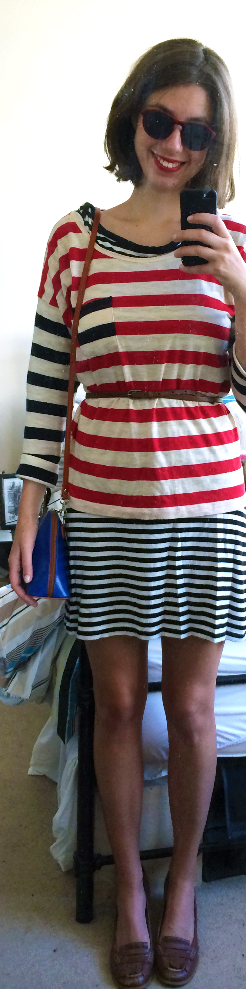 Striped Shift Dress ,  Striped T-Shirt ,  Skinny Brown Belt,   Brown Loafers ,  Cobalt Crossbody Bag ,  Round Sunglasses