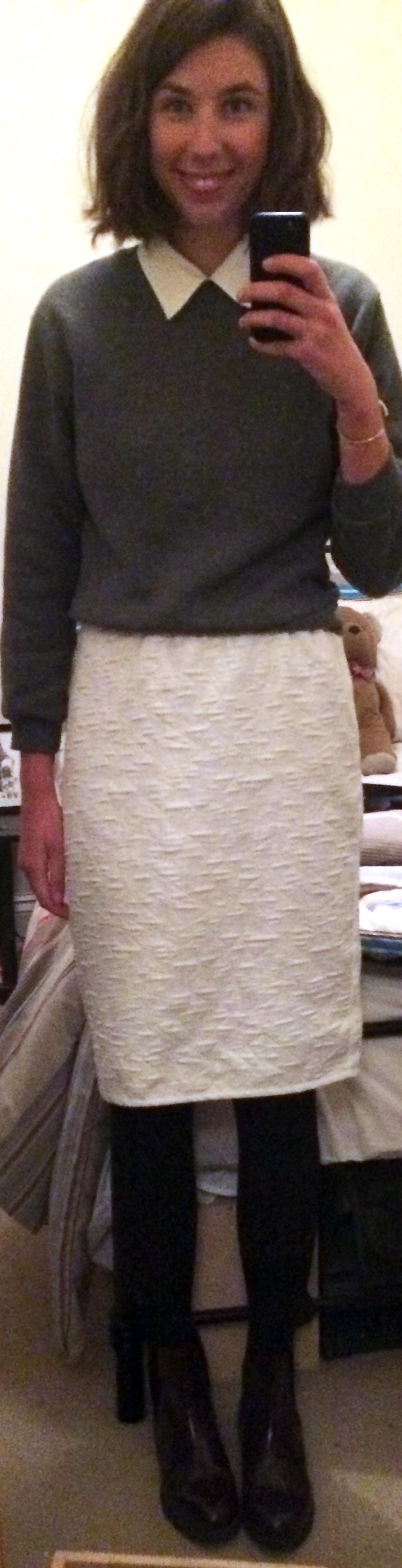 Thrifted Kids Sweatshirt,  White Skirt ,  White Button-Down Shirt ,  Black Knit Tights ,  Burgundy Chelsea Boots ,  Brass Cuff