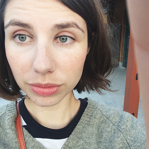 Naturally, took a selfie at the game.   Striped shirt is similar to this one from  Need Supply Co ., sweater is J.Crew , lip color is gone