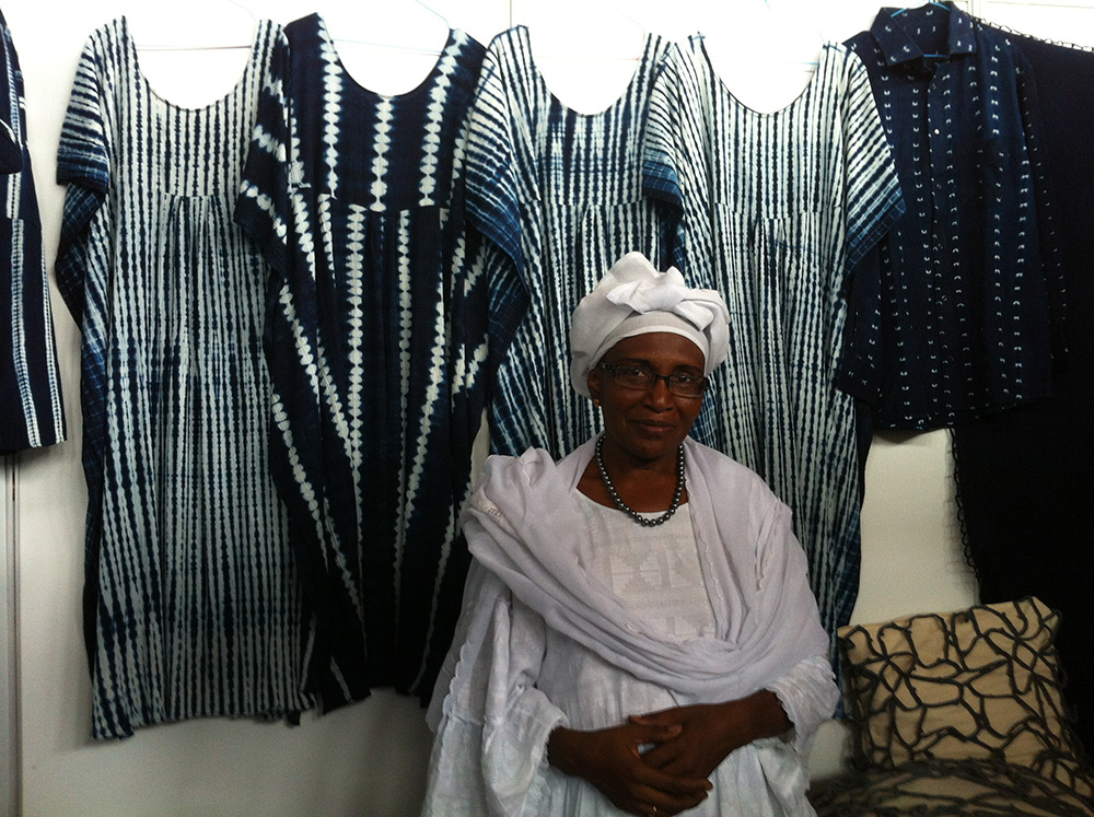 "A Malian artisan that creates dresses, crochet pillows, and bags for Proud Mary. Harper describes her as a ""master indigo dyer."""