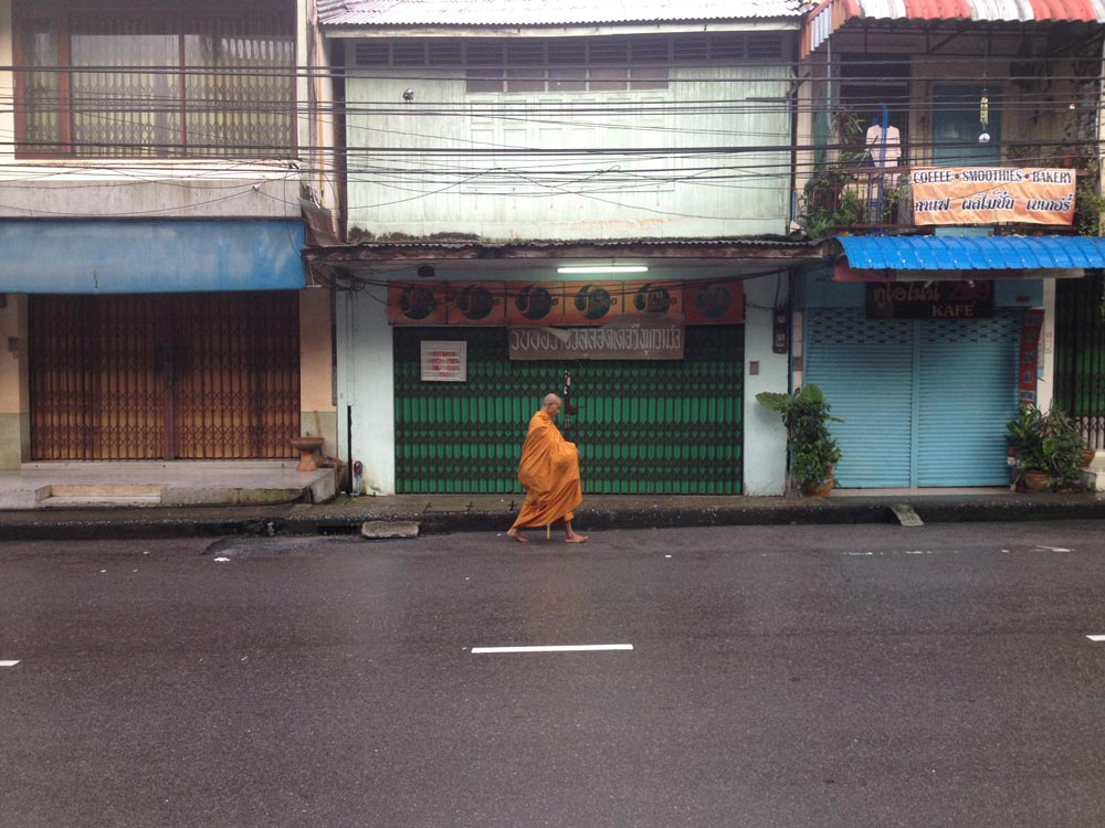 A lone monk walking down the street outside our home in ranong, thailand.   Photocredit elisabeth Cairnes