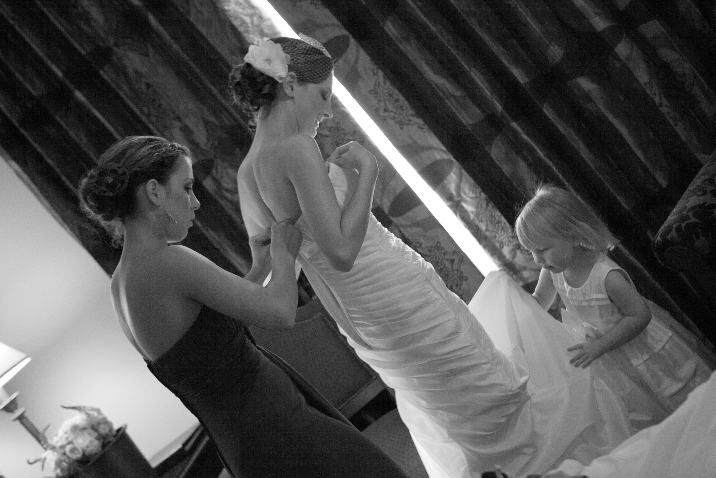 This picture is one of the most important ones. I was so nervous that I would get emotional when it was time to put on the dress because I would have my mom to help. Without even asking my maid of honor and two year old daughter hopped up and helped me out. That means more than they will ever know.