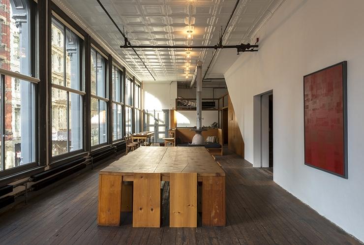 101 Spring Street, New York, 2nd Floor, 2013   Photo Credit: Josh White. Image © Judd Foundation. Art © Ad Reinhardt. Donald Judd Furniture © Judd Foundation.