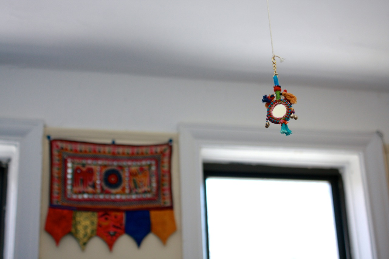 Marta's home is suffused with color and is even in the smallest of details, like these sweet light pulls in every room.